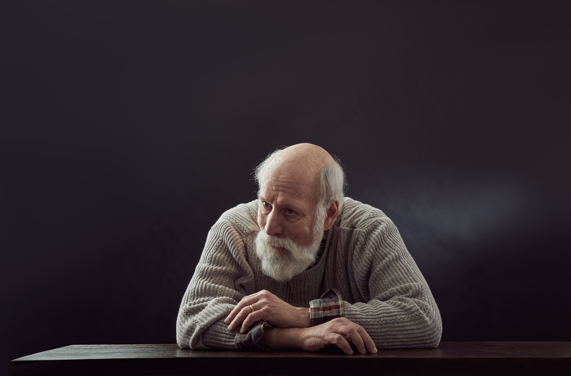 Bearded Man in Sweater at table