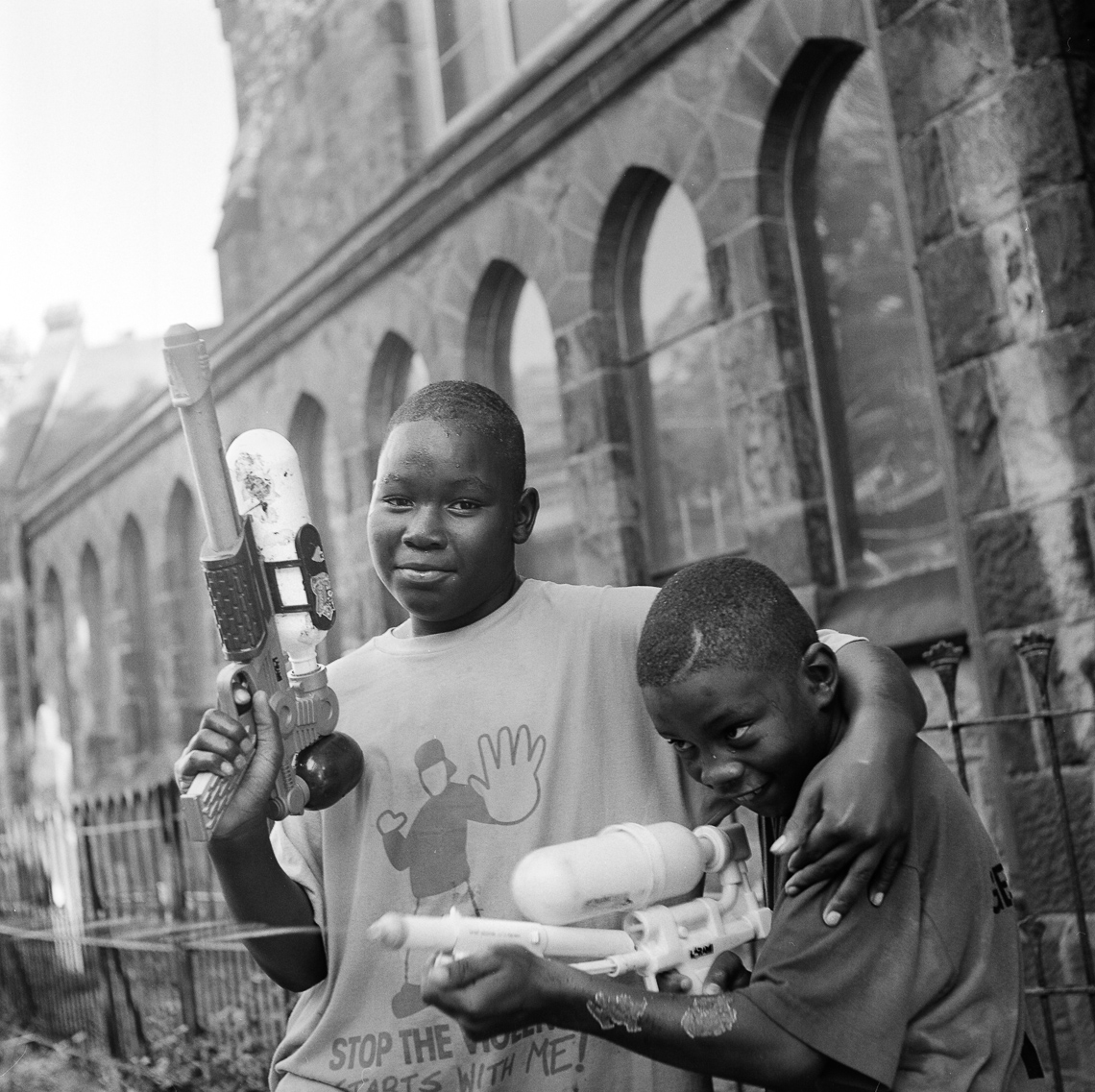 black-white-portrait-kids-water-guns