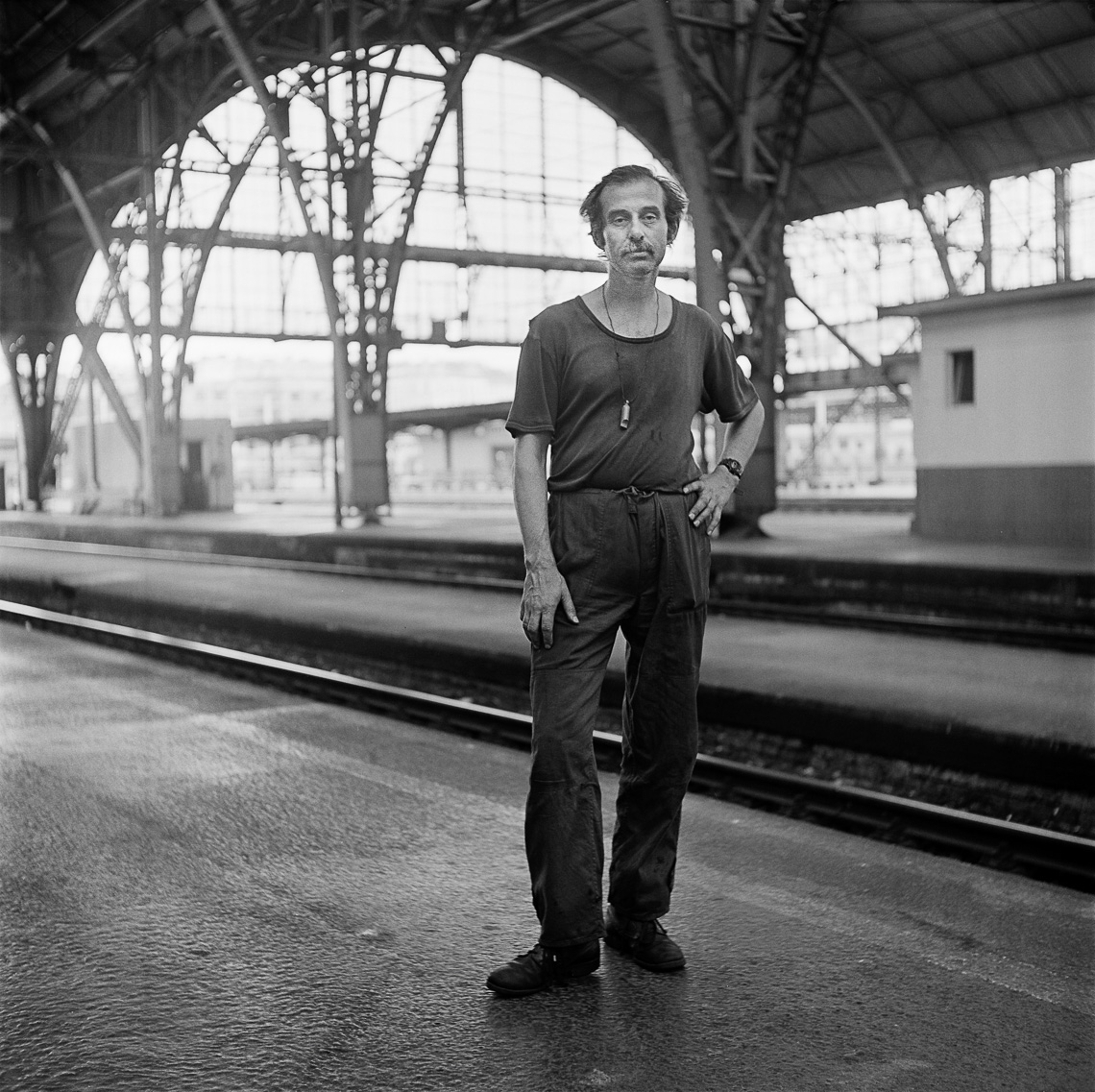 black-white-portrait-man-train-station