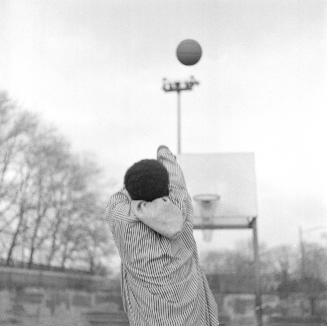 black-white-street-kid-basketball-hoop