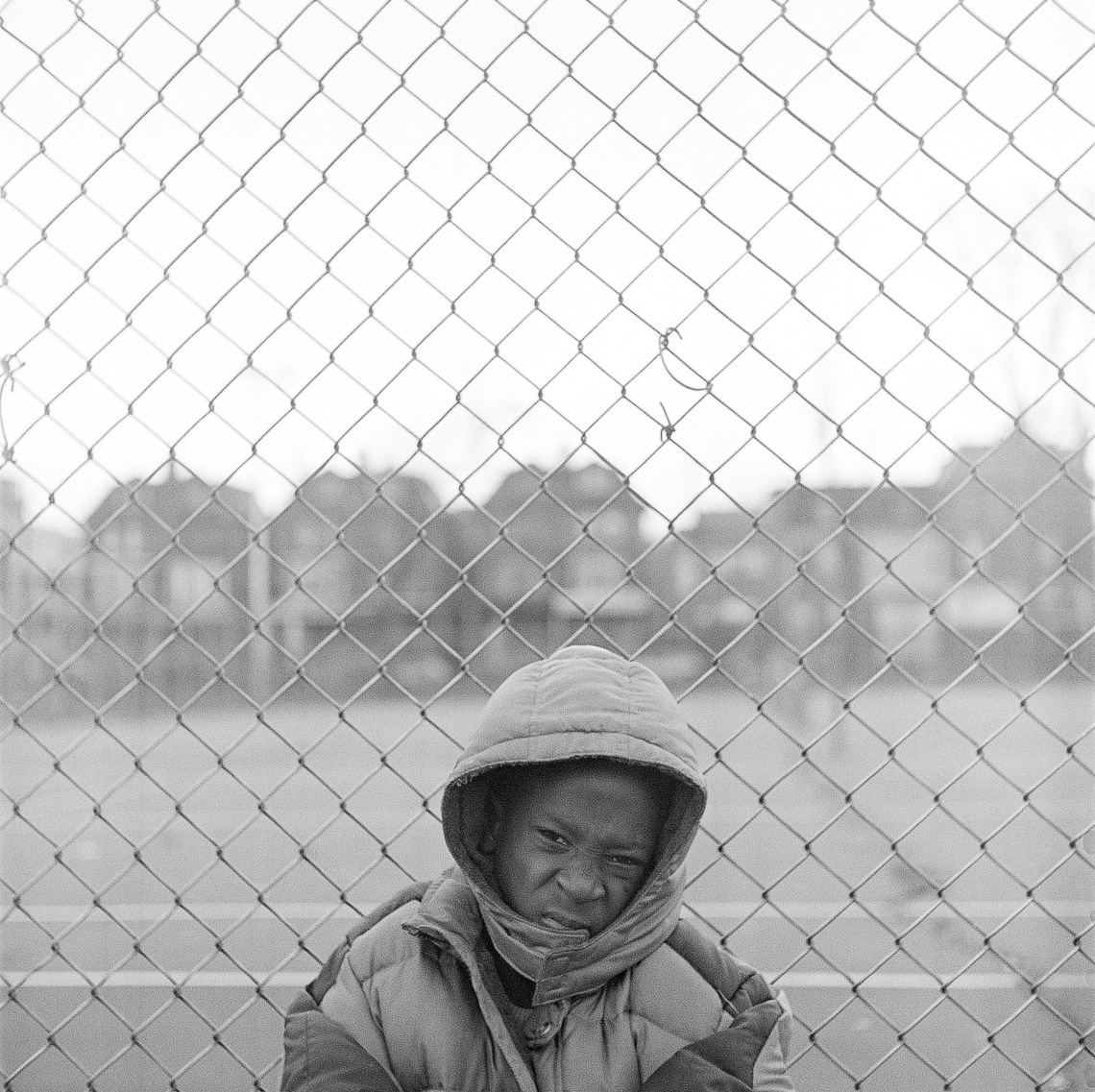 black-white-street-kid-fence-wind