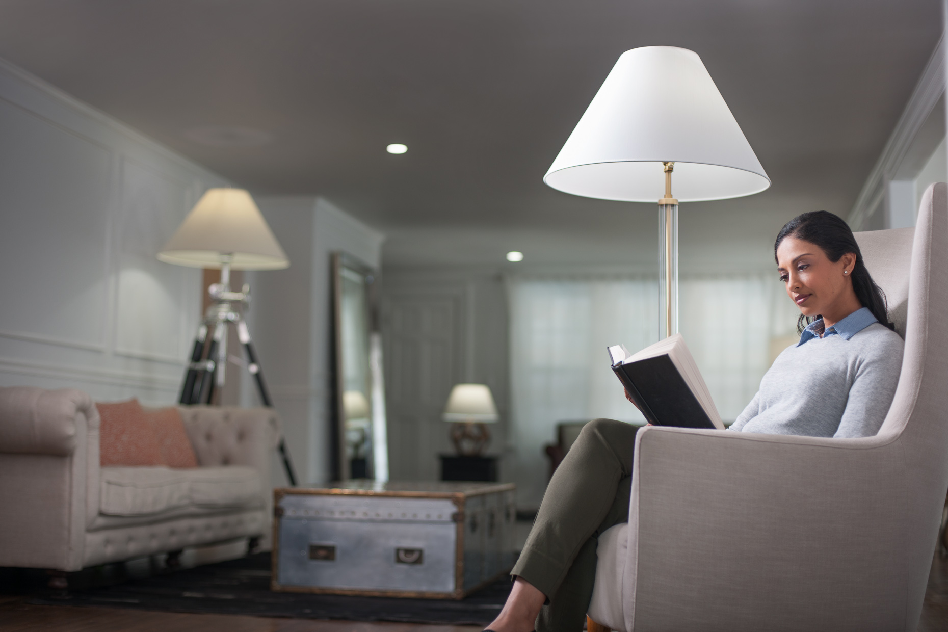 Woman reading in living room | Philips LED Commercial