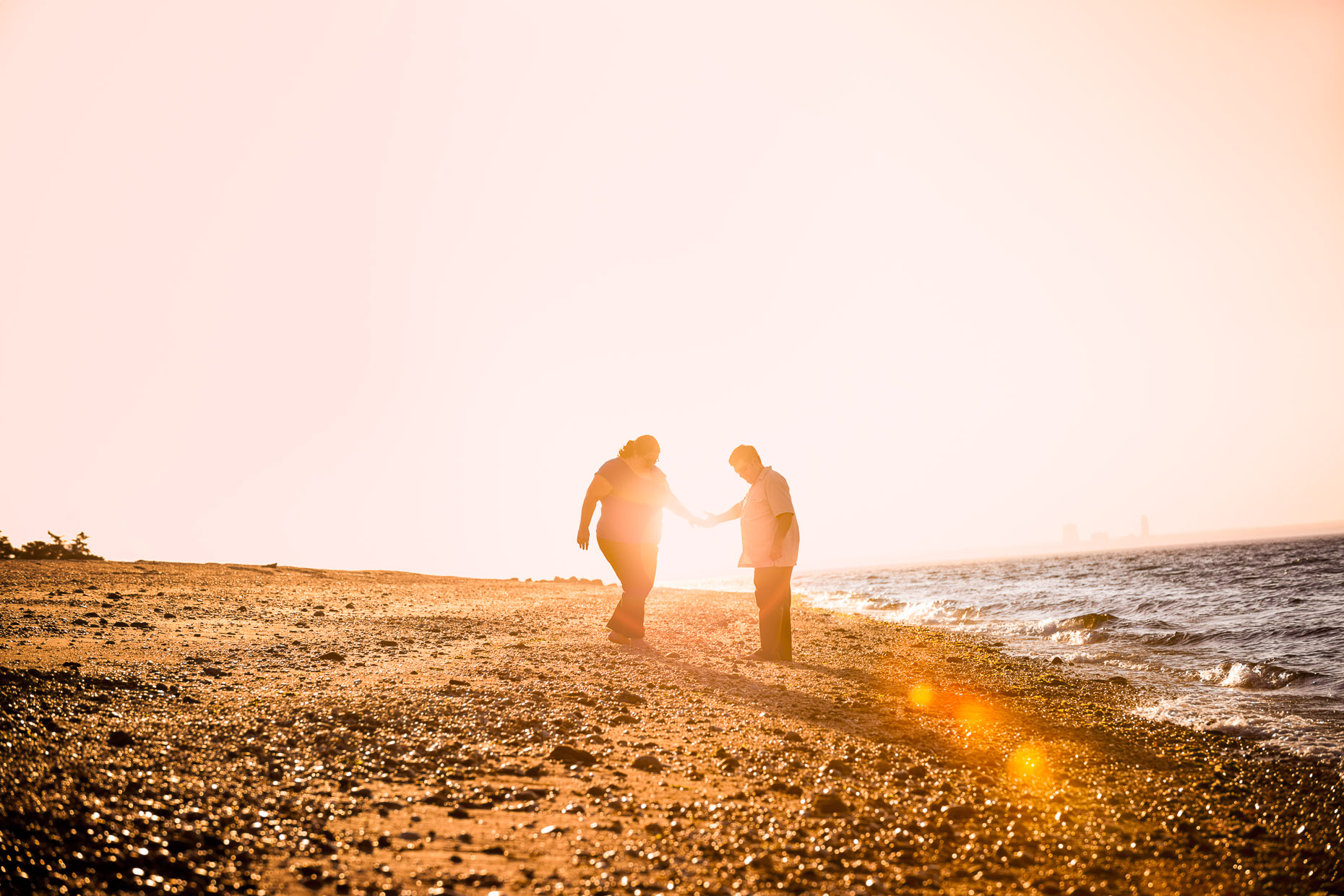 commercial-portraits-couple-beach-flare