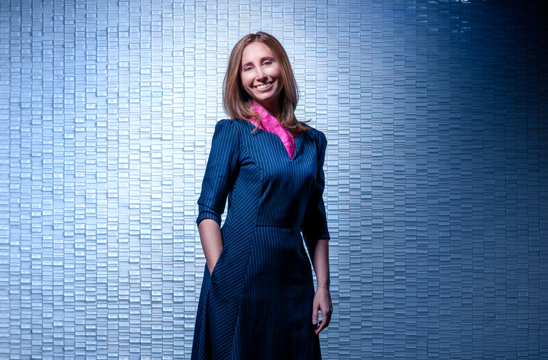 corporate-portrait-woman-blue-tile