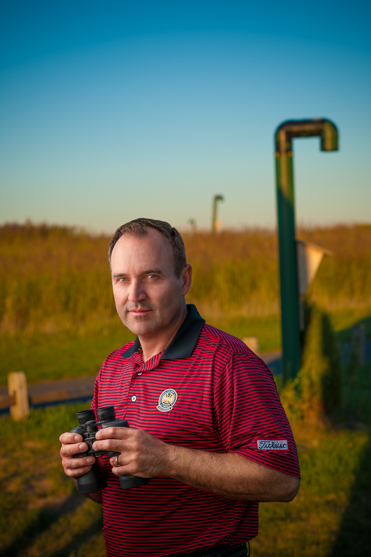 Mike Attara with binoculars | Eagle Ridge Golf editorial