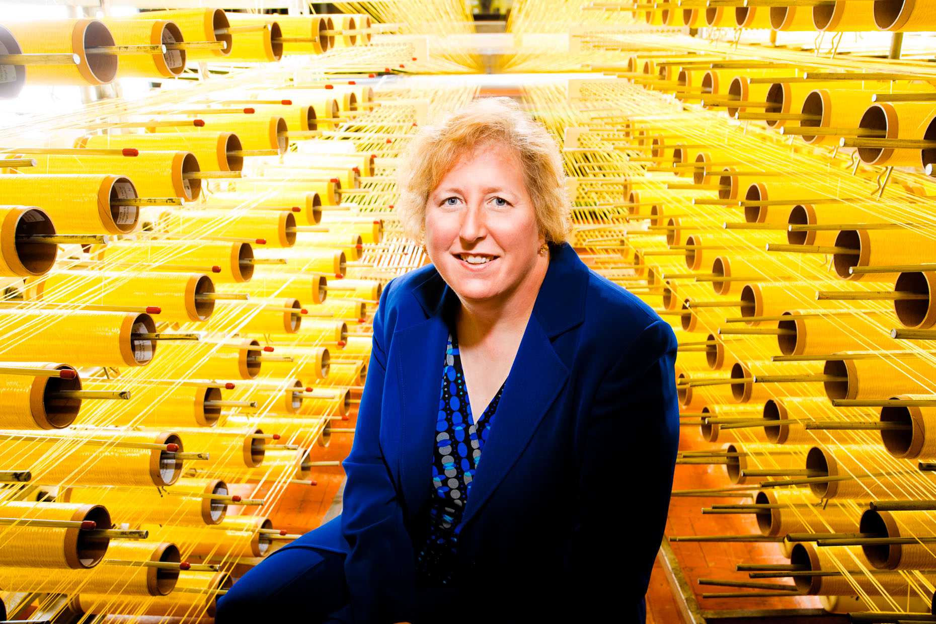 editorial-portraits-woman-yellow-spools
