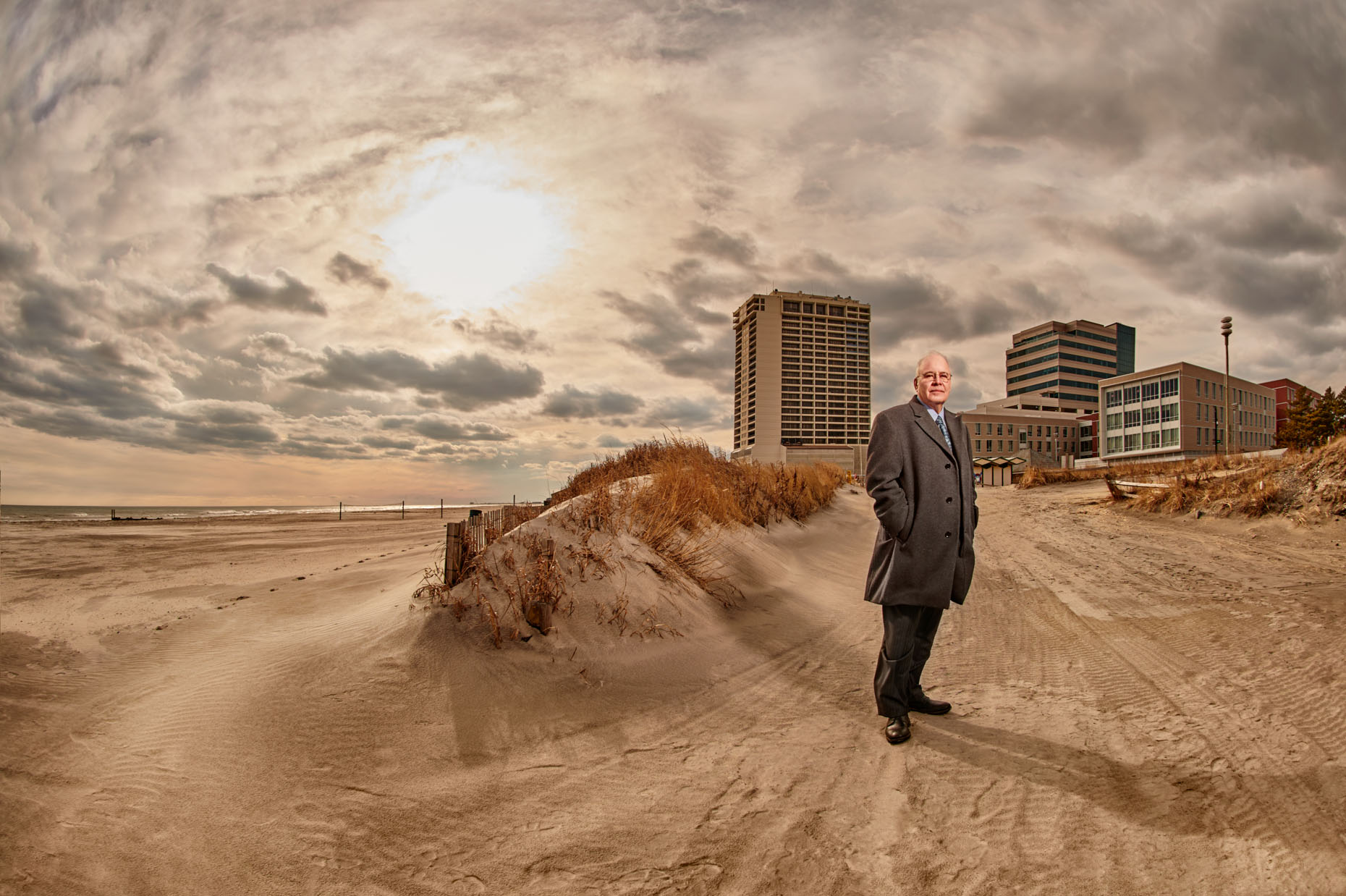 elderly-man-suit-beach-storm