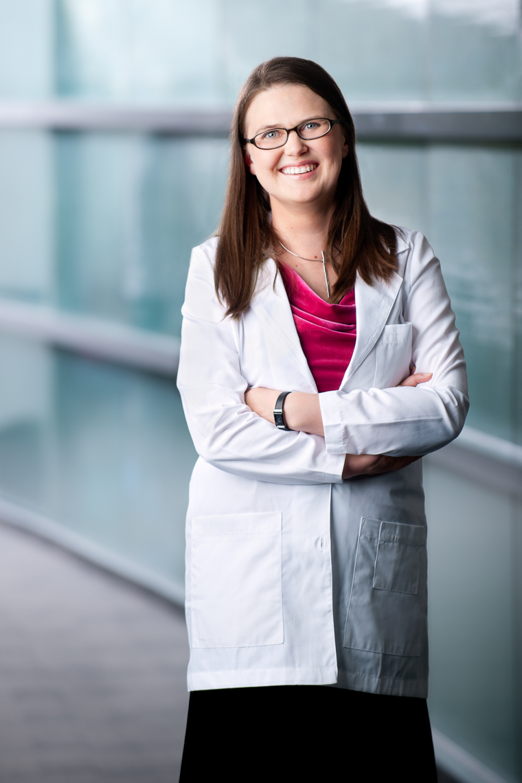 Female Scientist in lab coat | Commercial Photographer