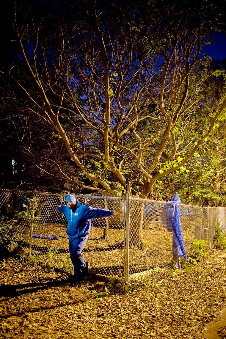 rwa-man-blue-hat-jacket-fence-tree-0132